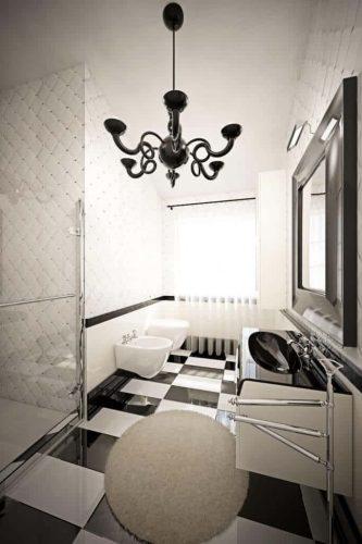 Phòng tắm cực kỳ hiện đại này có gạch lát sàn ca rô và phù hợp, bàn trang điểm nổi màu đen và trắng với bề mặt cong. Kính tắm đứng đứng bên trái.